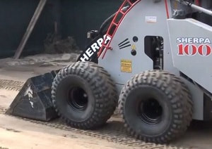 mini skid loader with bucket levelling fine sand