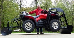 quad bike with discs and bucket attachments
