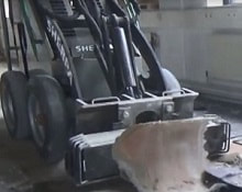 mini skid steer with carpet remover attachment