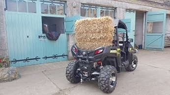road legal buggy z550 for sale carrying a bale of hay