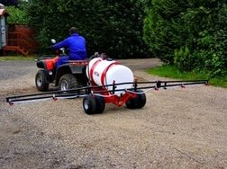 extra wide spray boom sprayer on quad bike