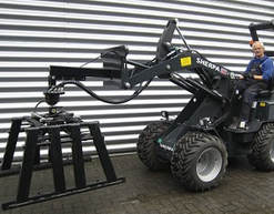 mini loader with curb clamp attachment