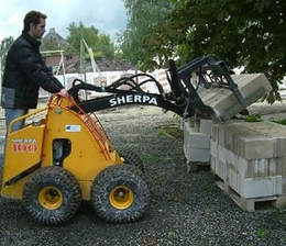 mini skid steer with curbstone clamp