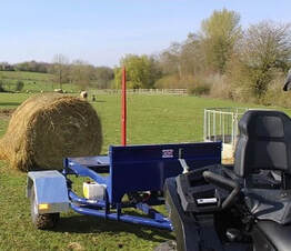 ATV hydraulic bale trailer with one spike