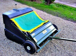 hard surface yard sweeper with cover plate