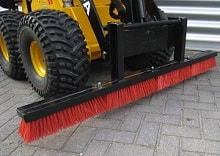 mini skid steer with push broom attachment