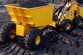 mini skid steer dumper filled with sand