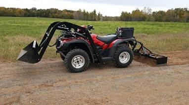 Farm quad with front bucket and rear leveller hydraulic attachments