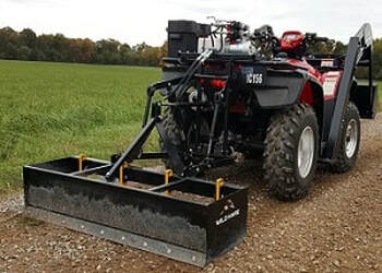 quad bike scraper blade grader levelling the soil