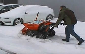 clearing snow with a muck truck snow plough attachment