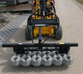 mini skid steer with grass tile clamp