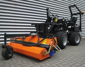mini skid steer with roller broom attachment