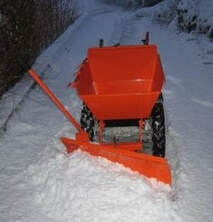muck truck with snow plough attachment