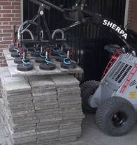 mini skid steer with vacuum lifting attachments