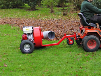 towable leaf blower blows leaves ready for collection